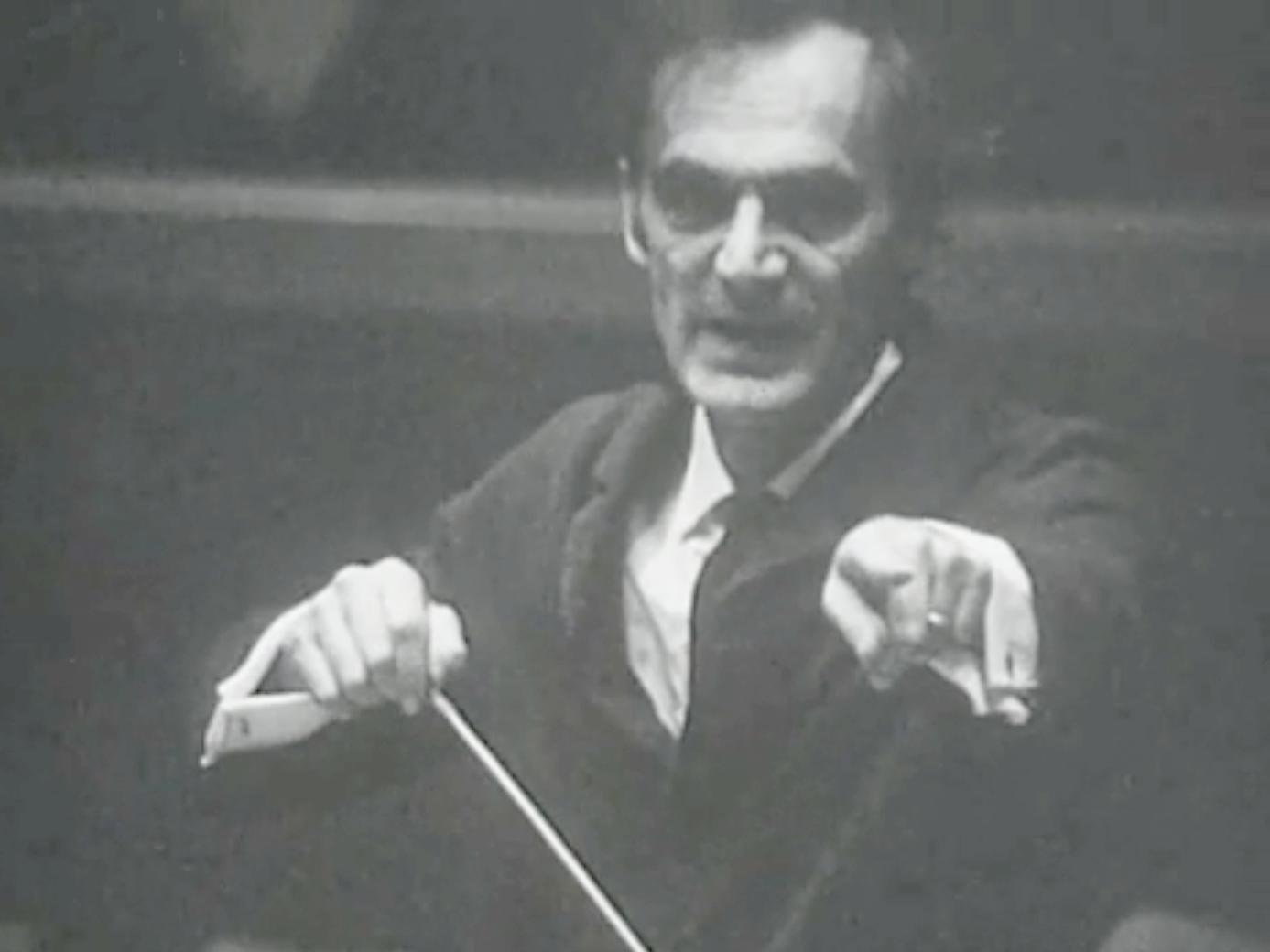 Jean-Marie AUBERSON, instantané cité de la vidéo «Le musicien - Un papa chef d'orchestre qui sait partager sa passion de la musique» du site des archives de la TSR, 1988, cliquer pour une vue agrandie